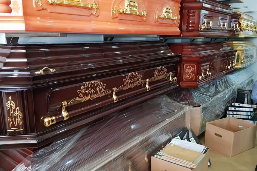 In a photo from Iras raids conducted on Sept 17, 2019, manual methods of accounting and record-keeping can be seen in the funeral parlour near coffins.