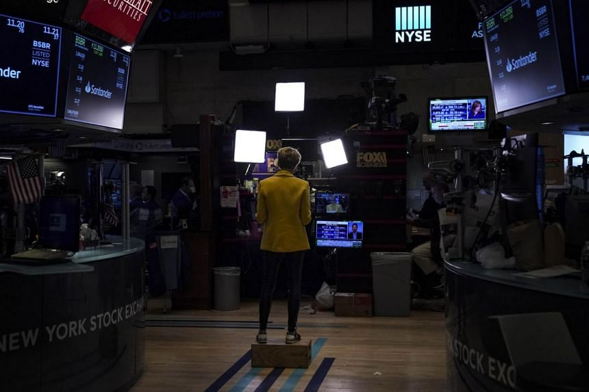 A reporter works on the floor of the New York Stock Exchange (NYSE) in New York City on Oct 11, 2019.