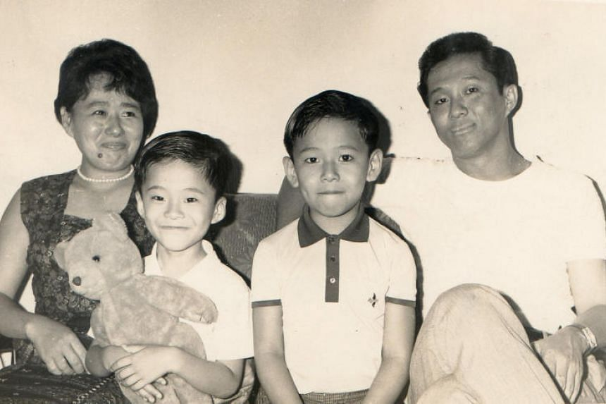 Mr Wee Toon Ouut and his wife, Madam Sim Suy Gek, with their sons, Liang Lian (left) and Liang Chee in a picture taken in the 1960s.