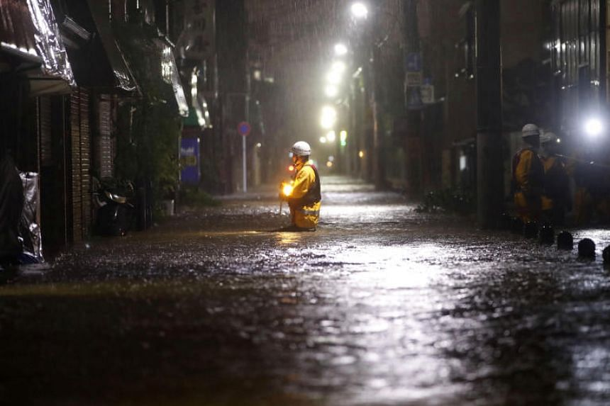 Firefighters patrol on a flooded road due to heavy rains caused by Typhoon Hagibis at Ota ward in Tokyo, Japan on Oct 12, 2019