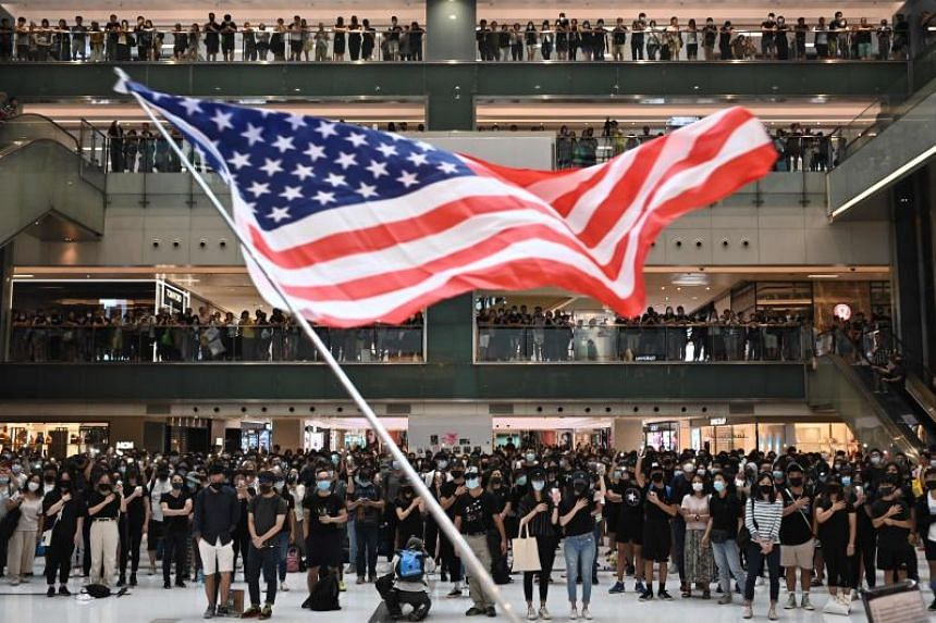 Protesters during a flash mob rally inside a shopping mall in Hong Kong's Sha Tin district on Oct 13, 2019.