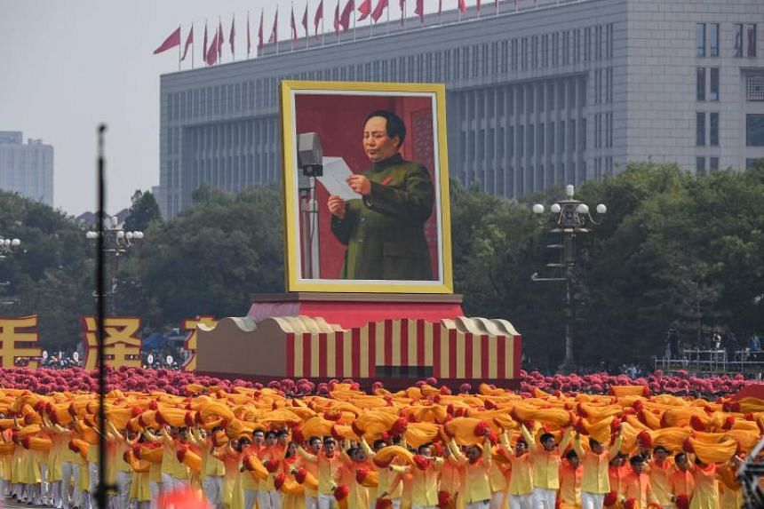 In a photo taken on Oct 1, a giant portrait of former Chinese Communist Party leader Mao Zedong passes by Tiananmen Square during the National Day parade in Beijing.