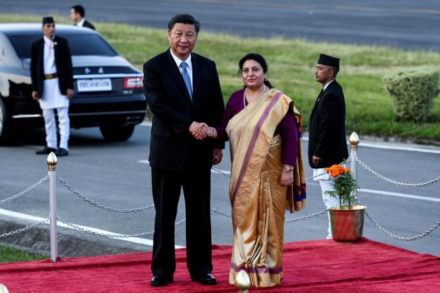 Nepalese President Bidhya Devi Bhandari with Chinese President Xi Jinping during a welcome ceremony at the Tribhuvan International Airport in Kathmandu on Oct 12, 2019.