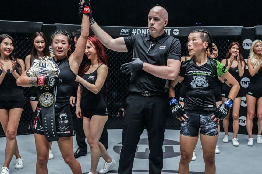 Angela Lee (left) produced a dramatic end to her title defence against Xiong Jingnan, submitting the Chinese fighter with just 12 seconds to go in their five-round match.