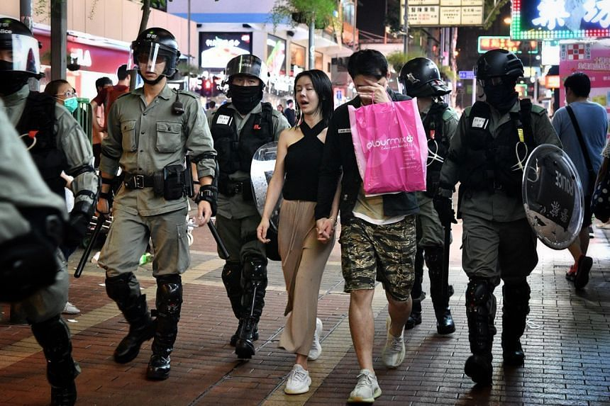 Protesters being detained in Mong Kok, Hong Kong, on Oct 13, 2019.