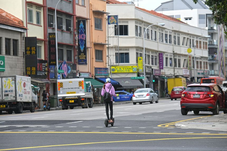 A personal mobility device (PMD) user travelling on the road last year before the ban kicked in on Jan 15, 2018. For the 700 cases of PMD riders detected flouting the law from January to September this year, LTA said that the PMDs were immediately im