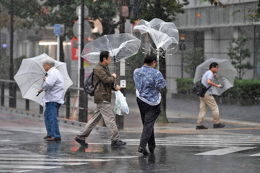 Damage to houses, cars and power poles believed to be caused by a tornado in Ichihara, east of Tokyo yesterday, according to Japanese media. Typhoon Hagibis comes as the destruction wrought by last month's Typhoon Faxai remains fresh in many minds. A