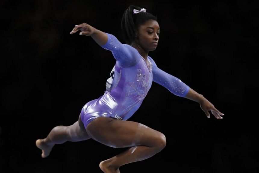 Simone Biles delivered a polished routine on the beam before a full twisting double tuck dismount for a score of 15.066.