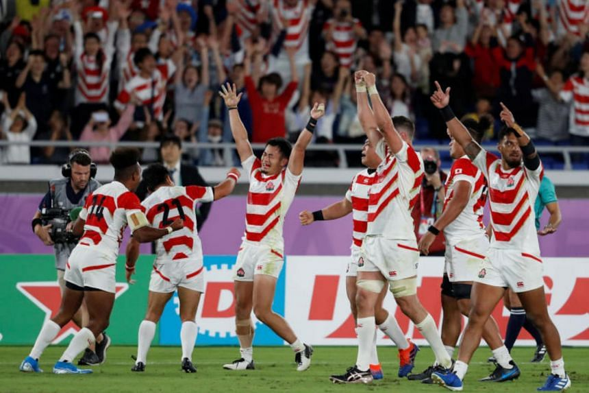 Japan players celebrate after beating Scotland 28-21 in their Rugby World Cup Pool A match at the International Stadium Yokohama in Japan on Oct 13, 2019.