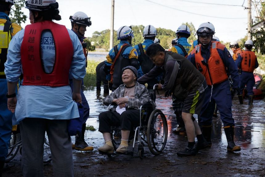 Elderly people being rescued from a nursing home after it was flooded by Typhoon Hagibis in Kawagoe, on Oct 13, 2019.