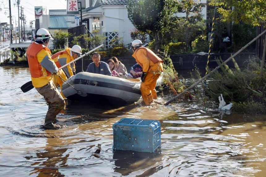 Rescue workers helping residents in an area flooded by Typhoon Hagibis in Date, Fukushima, on Oct 13, 2019.