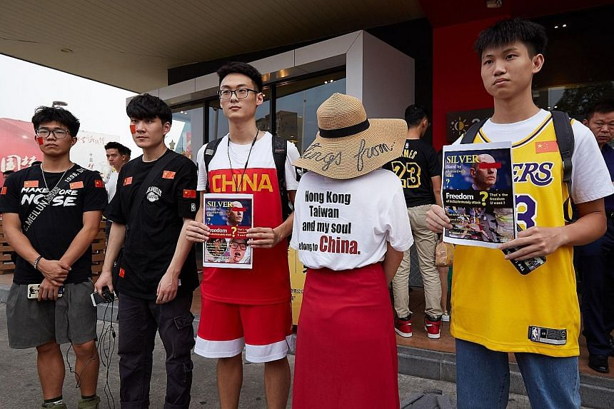 Chinese fans making their feelings known before attending a pre-season NBA game in Shenzhen, China, on Saturday.