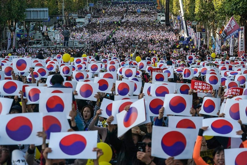 Supporters of Justice Minister Cho Kuk, taking to the streets in Seoul on Saturday. His supporters insist that the allegations against him are exaggerated by the opposition and believe that the prosecution is trying to bring him down so as to stop hi