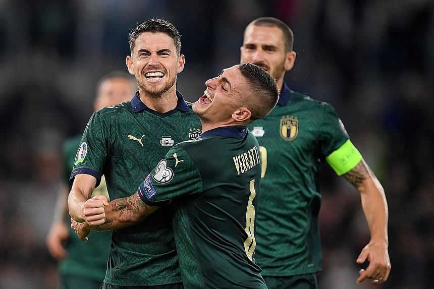 Italy's Jorginho celebrating with Marco Verratti after scoring their first goal from the penalty spot. The Azzurri defeated Greece 2-0.