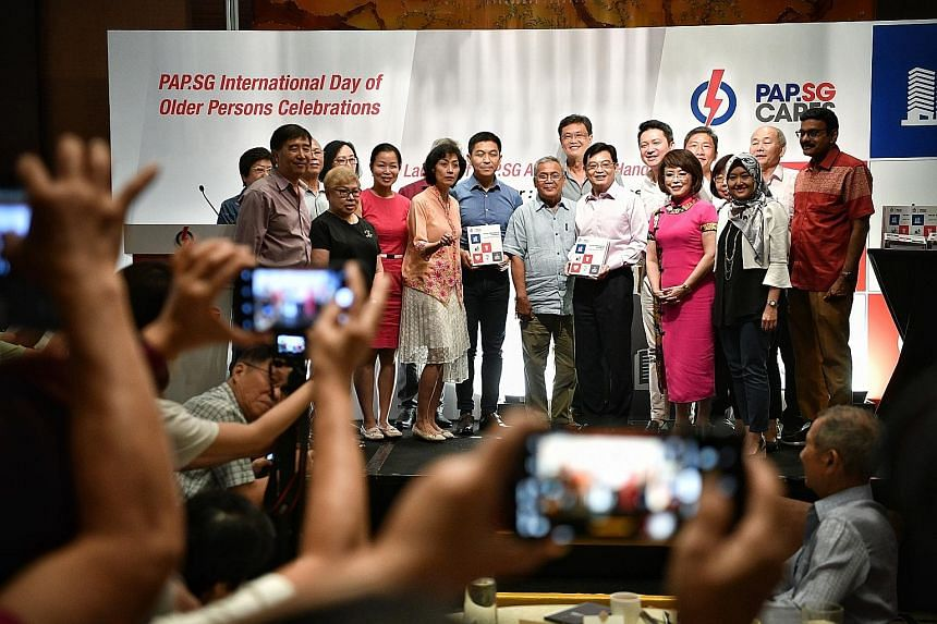 Deputy Prime Minister Heng Swee Keat with the People's Action Party Seniors Group executive committee, which includes Ms Cheng Li Hui, Ms Joan Pereira, Mr Tan Chuan-Jin, Mr Henry Kwek, Dr Lily Neo and Ms Rahayu Mahzam. ST PHOTO: ARIFFIN JAMAR