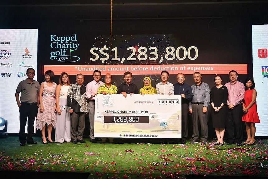 President Halimah Yacob with representatives of the 10 local charities that will benefit from the funds raised by the annual Keppel Charity Golf fund-raiser, at the Keppel Club yesterday. Proceeds will be divided equally among the charities after $50