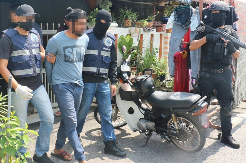 Counter-terror police arresting men said to be sympathisers of the defunct Liberation Tigers of Tamil Eelam. Two ethnic Indian Democratic Action Party assemblymen were among the 12 men nabbed.