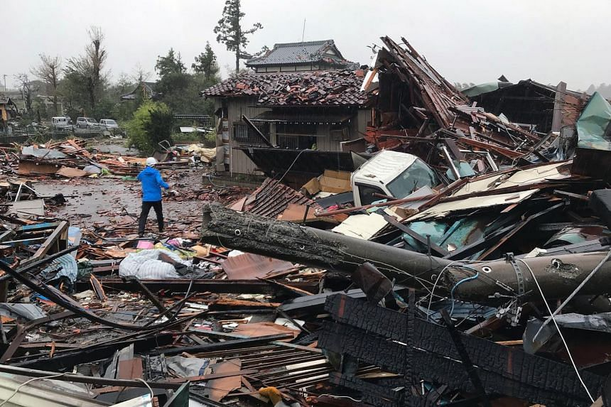 Damaged houses caused by weather patterns from Typhoon Hagibis are seen in Ichihara, Chiba prefecture on Oct 12, 2019.