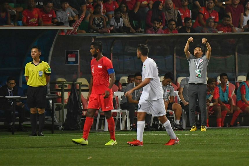 A photo taken on Sept 10 shows Lions coach Tatsuma Yoshida giving instructions to players during the World Cup Qualifier against Palestine. Singapore went on the beat Palestine 2-1.