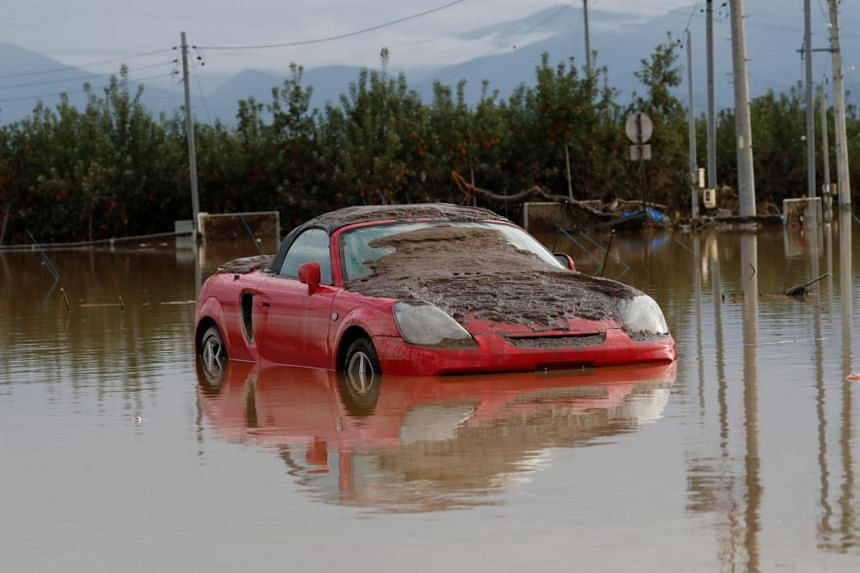 A car partially submerged in a flooded area in the aftermath of Typhoon Hagibis, which caused severe floods at the Chikuma River in Nagano Prefecture, Japan on Oct 14, 2019.