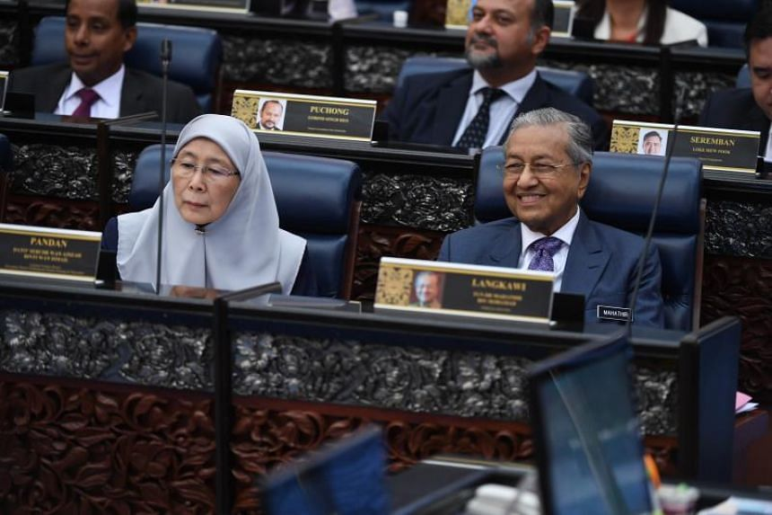 A photo taken on Oct 11 shows Malaysian Deputy Prime Minister Wan Azizah Wan Ismail and Prime Minister Mahathir Mohamad during the 2020 budget presentation at the Parliament House in Putrajaya.