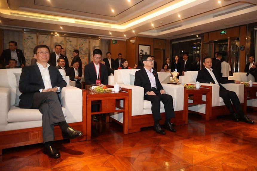 Deputy Prime Minister Heng Swee Keat with Chinese Vice-Premier Han Zheng (left) and Chongqing party boss Chen Min'er on board a river cruise in Chongqing on Oct 14, 2019.