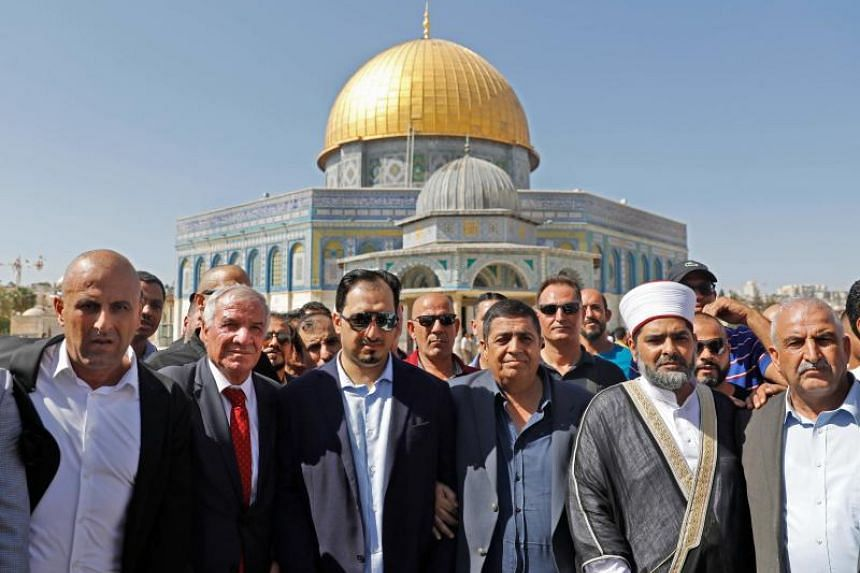 Saudi Football Federation chief Yasser Almisehal (centre) and members of the Saudi football delegation visit the Noble Sanctuary, a compound that houses the Golden Dome of the Rock and Al-Aqsa Mosque, in the Old City of Jerusalem on Oct 14, 2019.