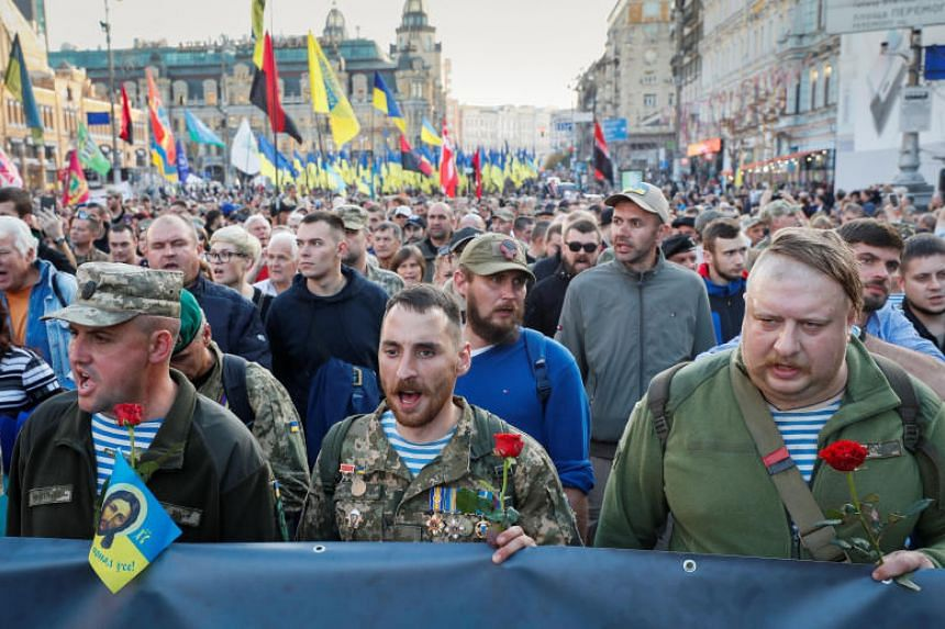 Veterans and supporters of Ukraine's nationalist movements take part in a rally against the approval of the so-called Steinmeier Formula in Kiev on Oct 14, 2019.