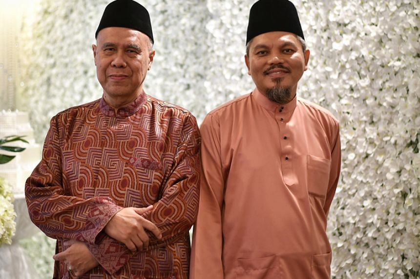 Ustaz Syed Ahmad Syed Mohamed (left) will step down on Oct 22 as the Registrar of Muslim Marriages, and will be succeeded by Ustaz Nor Razak Bakar.