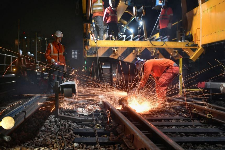 A photo taken on Sept 9, 2018, showing rail maintenance works being done at Boon Lay MRT station. Transport Minister Khaw Boon Wan said that a unified approach between regulator and regulated was required in tackling rail issues.