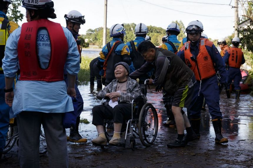 Elderly residents being rescued from a nursing home that was flooded by Typhoon Hagibis in Kawagoe, Japan, on Oct 13, 2019.
