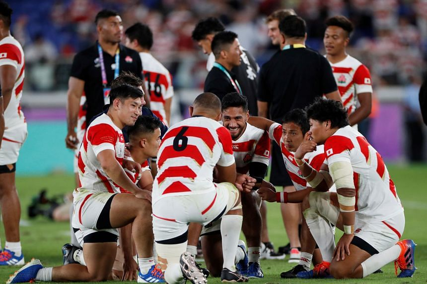 The Japan rugby team celebrating after yesterday's victory in Yokohama.