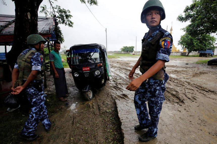A photo taken on July 9 shows Myanmar police officers in Maungdaw in Rakhine state. Myanmar's army has deployed thousands of troops to the state to try to crush rebels.