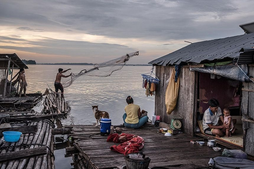 A floating home on the Mekong River in Cambodia. Securing a steady supply of power is a big challenge for the kingdom.