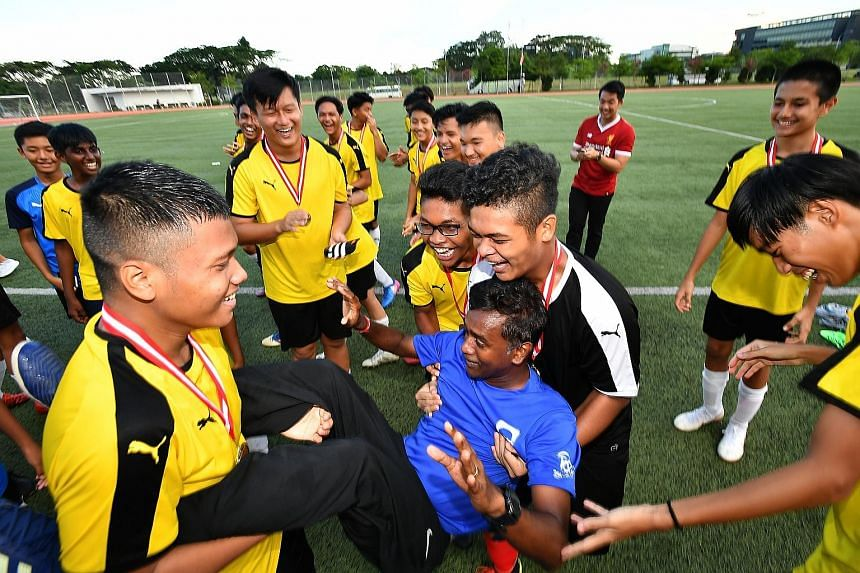 Jubilant members of Guangyang Secondary School's football team carrying coach Arumugam Kaliappan after winning the Schools National B Division League Two title in April. Arumugam and Northbrooks Secondary's Sanjay Radakrishna (above) were among 10 re
