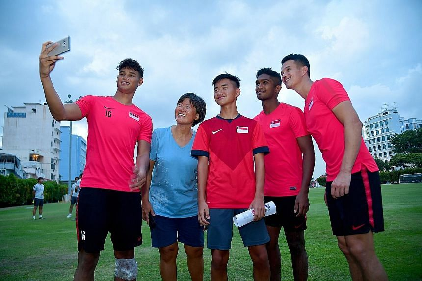 While more than 20,000 fans were at the National Stadium for Brazil's friendly against Nigeria on Sunday, two Singaporeans were at the Geylang Lorong 12 field to watch the Lions prepare for today's World Cup qualifier against Uzbekistan. Royce Yap (i