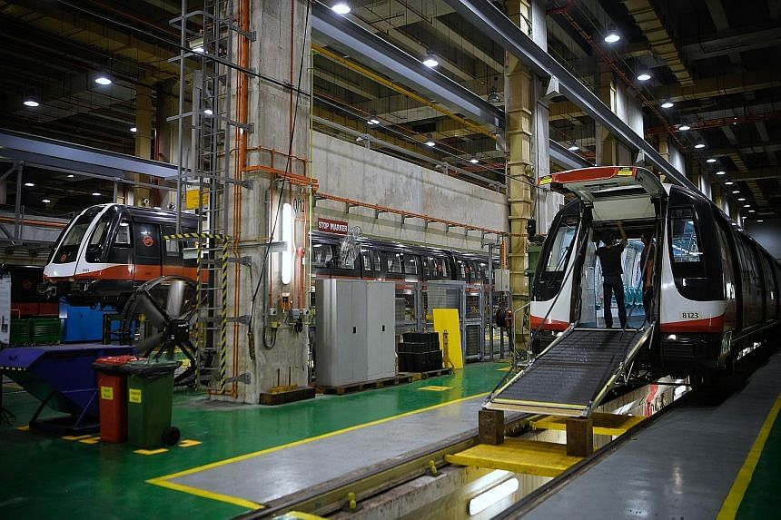 Trains at the train workshop in the SMRT Kim Chuan Depot last year. Transport Minister Khaw Boon Wan said Singapore has corrected the under-investment in operations and maintenance, but warned against going overboard in future, at the expense of comm