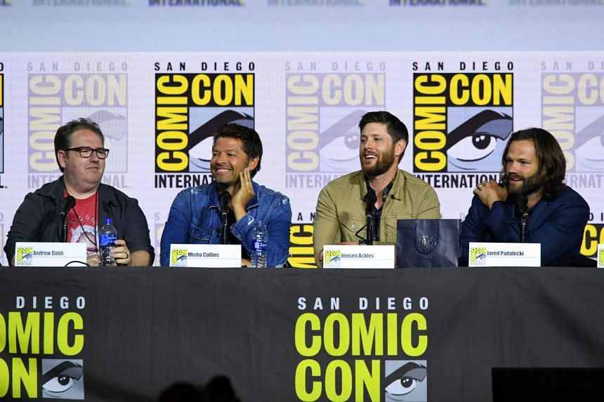 """In a photo taken on July 21, Andrew Dabb, Misha Collins, Jensen Ackles, and Jared Padalecki attend the """"Supernatural"""" Special Video Presentation and Q&A during 2019 Comic-Con International at San Diego Convention Center."""