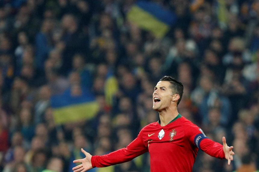 Portugal's forward Cristiano Ronaldo celebrates during the Euro 2020 football qualification match between Ukraine and Portugal on Oct 14, 2019.