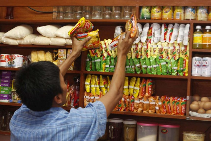 A vendor in Jakarta arranges packets of instant noodles on a shelf. Indonesia was the world's second-biggest consumer of instant noodles, behind China, with 12.5 billion servings in 2018, according to the World Instant Noodles Association.