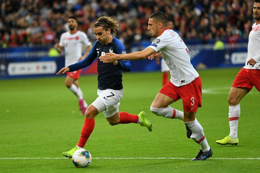 France's Antoine Griezmann (left) and Turkey's Merih Demiral battle for the ball during the the UEFA EURO 2020 qualifying Group H soccer match between France and Turkey at the Stade de France on Oct 14, 2019.