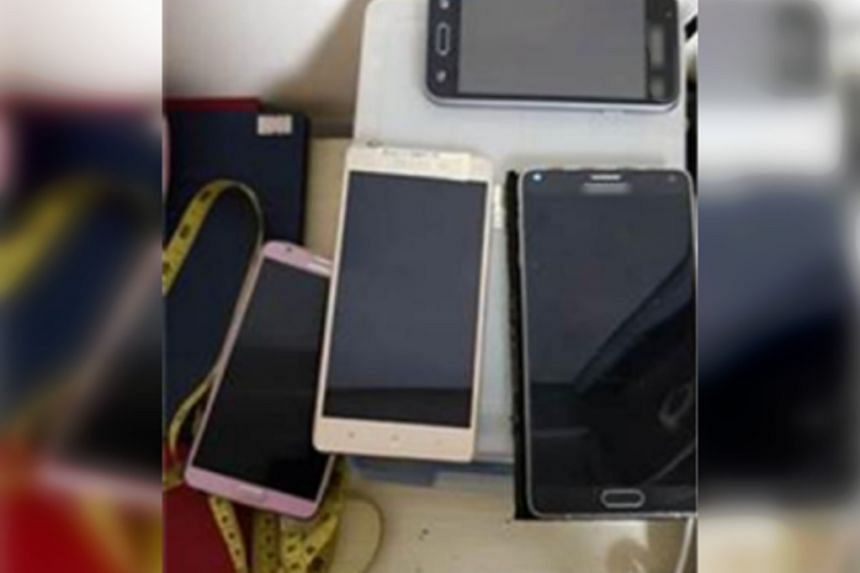 More than 10 electronic devices - including a central processing unit, a laptop, a harddisk and several mobile phones - were seized.