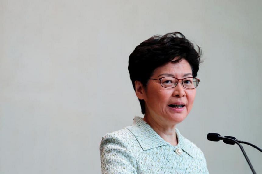 Hong Kong Chief Executive Carrie Lam speaks to journalists before a weekly Executive Council meeting in Hong Kong on Oct 15, 2019.
