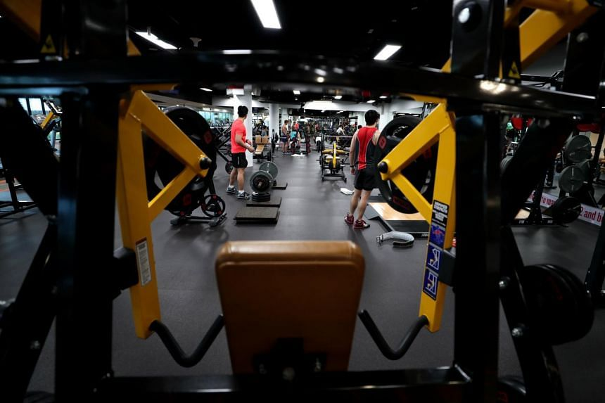 People working out at a gym in Punggol Safra, on Sept 2, 2018.