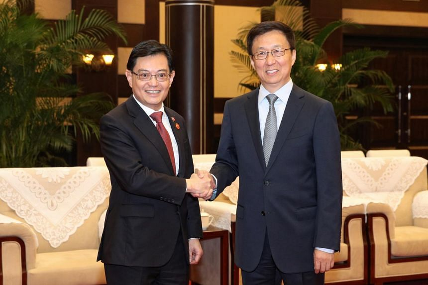 Deputy Prime Minister Heng Swee Keat (left) and Chinese Vice-Premier Han Zheng in Chongqing, China. Singapore and China signed a raft of pacts at their 15th Joint Council for Bilateral Cooperation meeting.