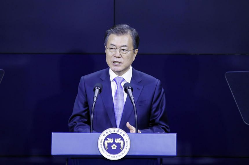 South Korea's Moon Jae-in (pictured) was forced to issue a public apology after his justice minister, Cho Kuk, bowed to a series of mass protests and resigned.