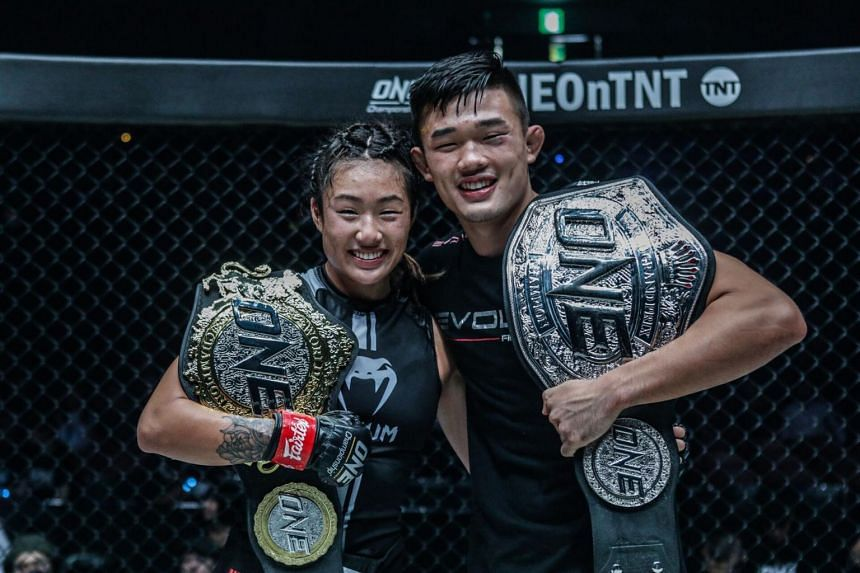 ONE Championship fighter Angela Lee with her brother Christian, after they won their bouts at the ONE: Century event in Tokyo on Oct 13, 2019. They were listed on ESPN's top 25 MMA fighters under 25.