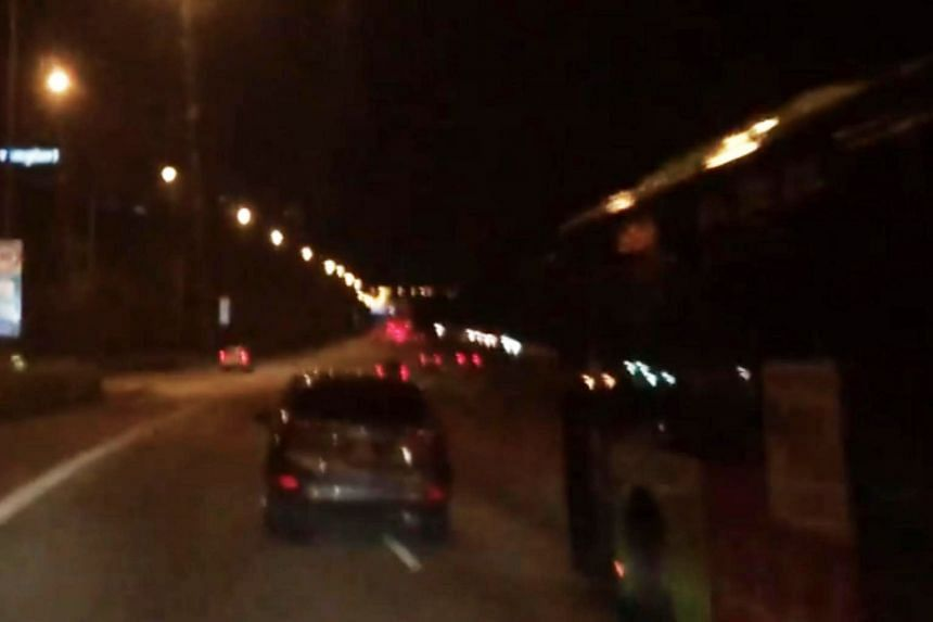 In a video posted on the Roads.sg Facebook page, a car, presumably driven by the suspected drink driver, nearly collides with other vehicles on the road several times.