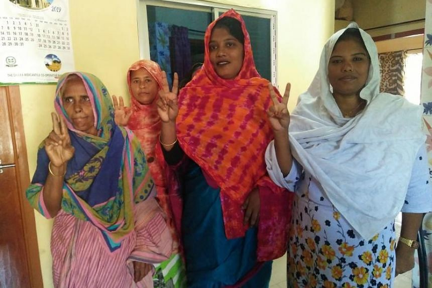 Pinki Khatun (second from right), the first transgender candidate elected in Bangladesh, with local women in Kotchandpur on Oct 14, 2019.