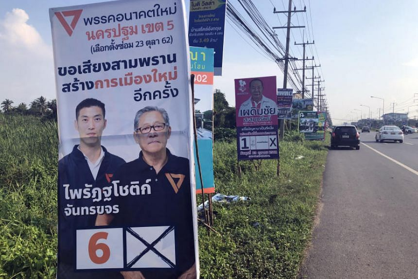 Election campaign posters of the Future Forward Party and the Chart Thai Pattana Party in Nakhon Pathom province.